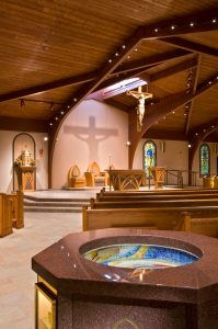 View of renovated worship space, baptismal font and altar area