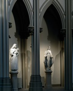 Statues from around the church were relocated to the apse to create a Communion of Saints behind the altar platform.