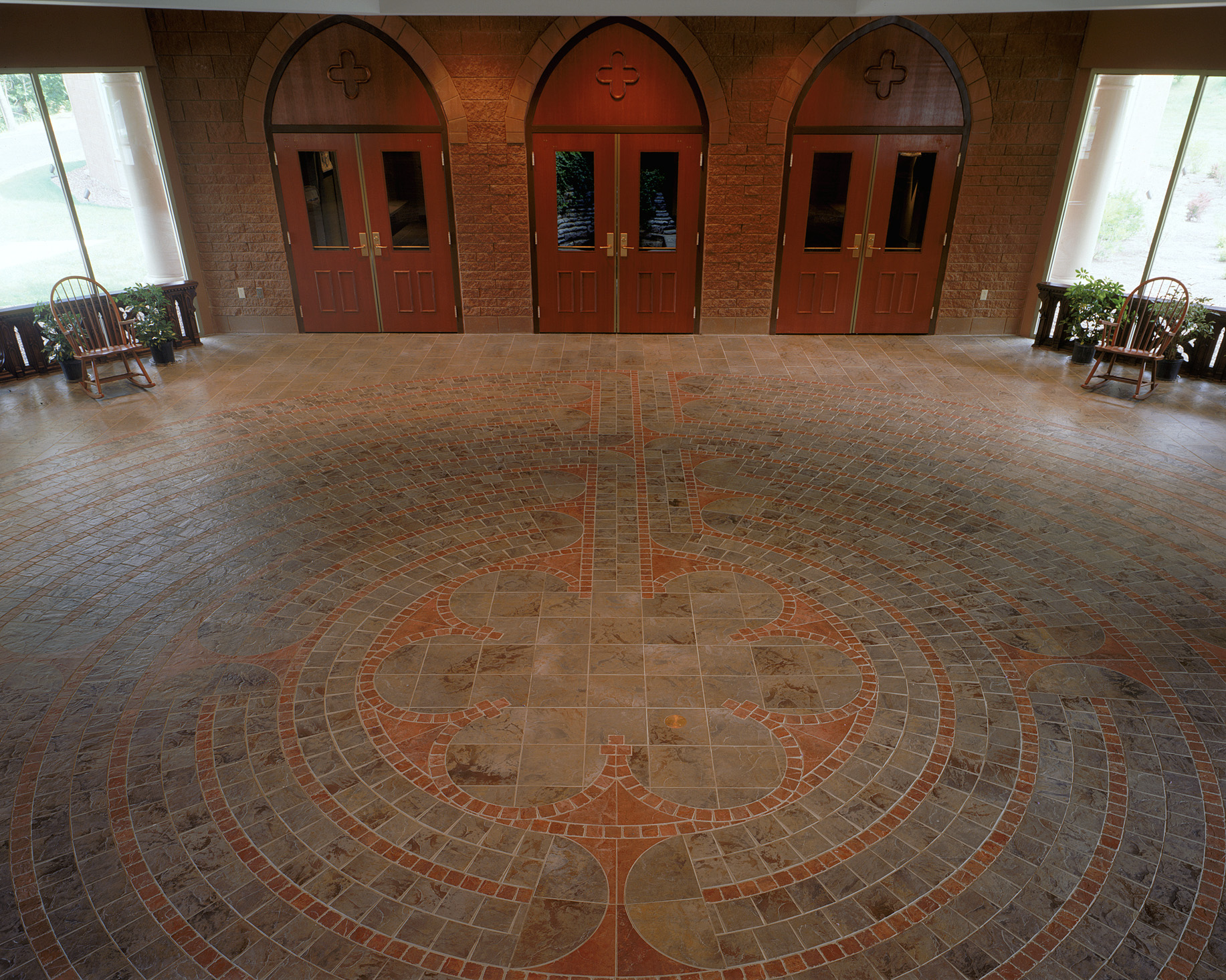 A labyrinth is incorporated into the narthex floor in subtle materials.