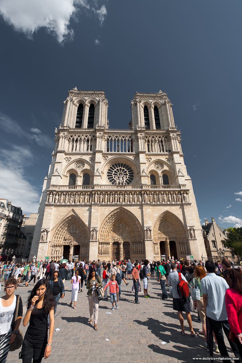 Tourists At Notre Dame De Paris