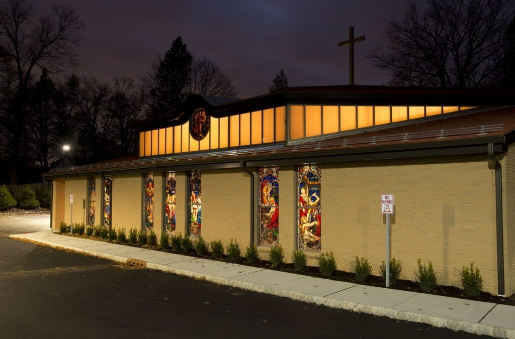 Light shines out at St. Joseph Church by Foresight Archietcts