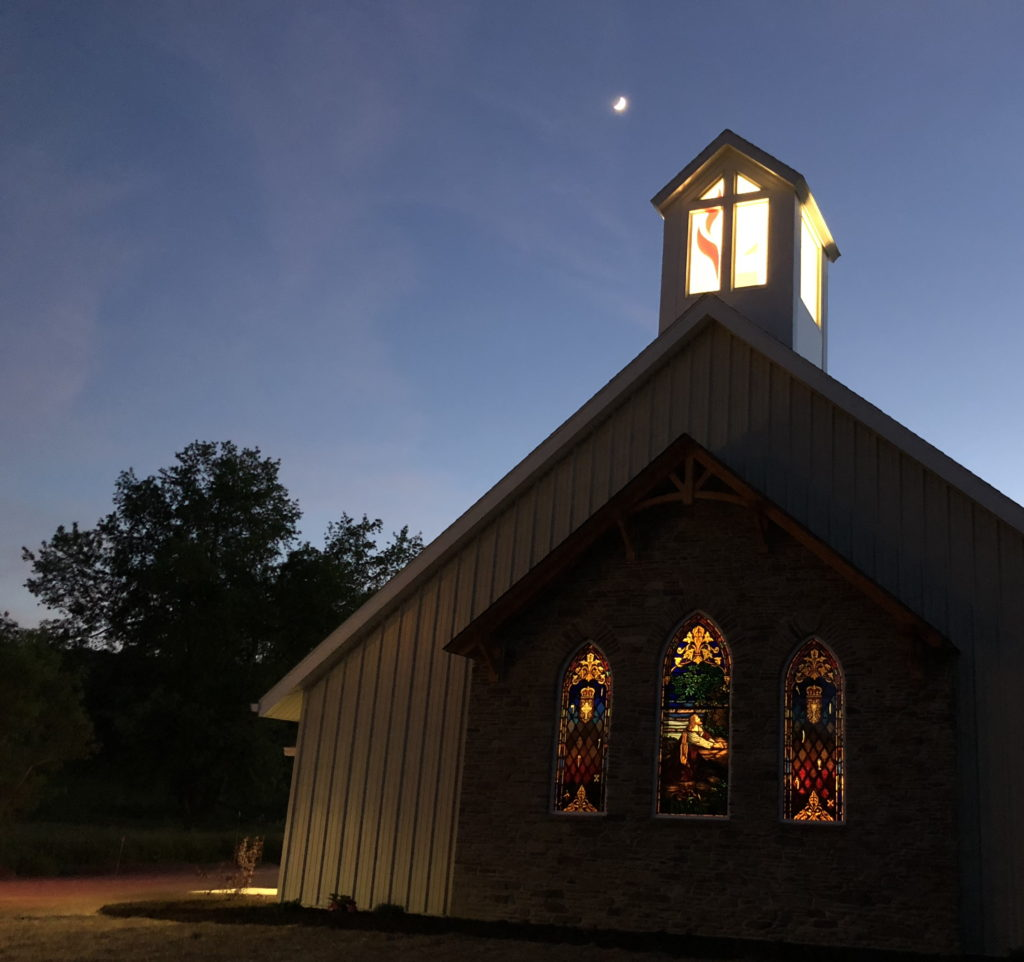 Photo of the illuminated lantern atop the new Milford United Methodist Church, designed by Foresight Architects