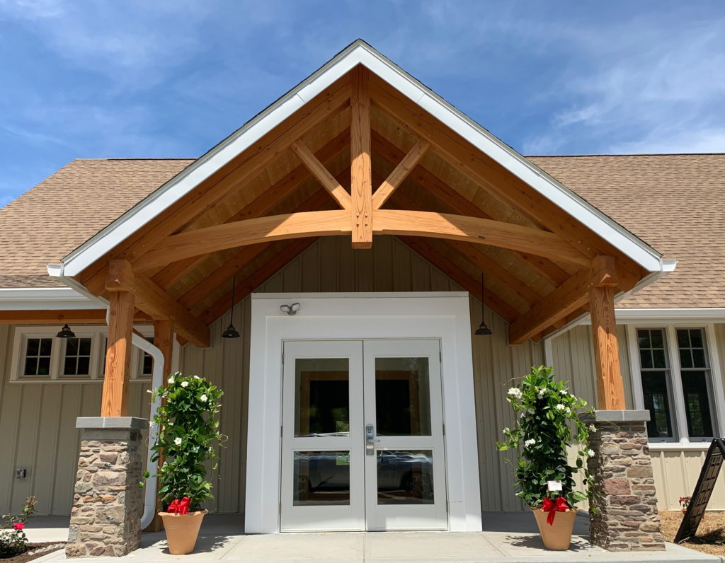 This photo shows the main entry to Milford United Methodist Church, topped by a beautiful heavy timber arch.